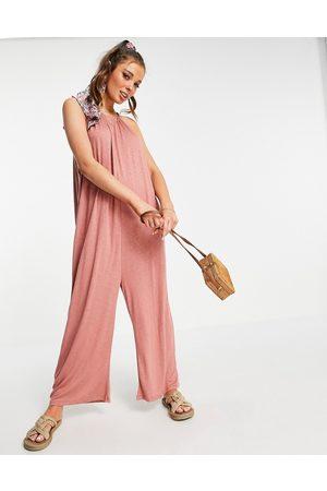 ASOS Textured tie halter jumpsuit in dusky rose-Pink
