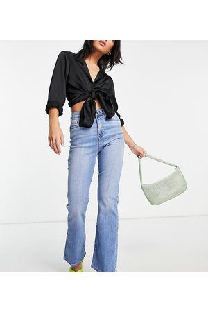 ASOS ASOS DESIGN Petite high rise 'Y2K' stretch flare jeans in midwash-Blue