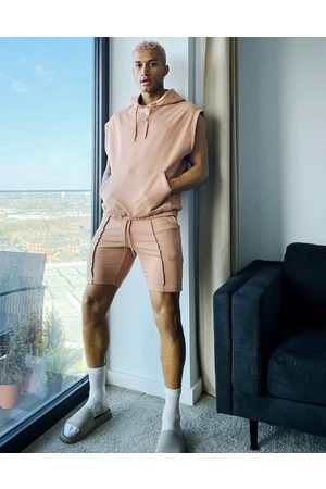 ASOS DESIGN Tracksuit with sleeveless hoodie and super skinny shorts in light brown-Pink