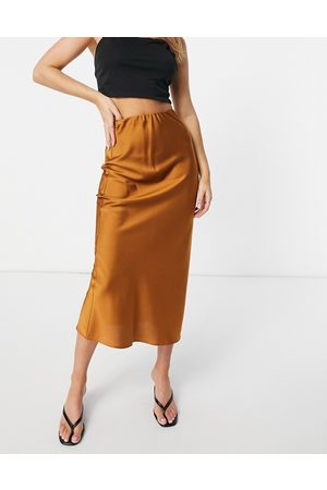 ASOS DESIGN Satin bias slip midi skirt in tan-Brown