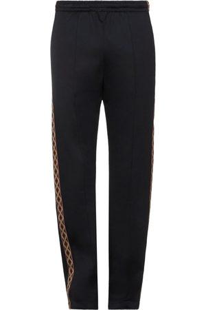 MARCELO BURLON Casual pants