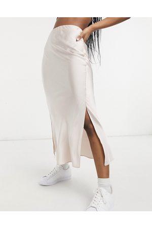 ASOS Satin bias slip midi skirt with splits in soft pink-White