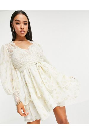 ASOS Soft mini skater dress in ditsy floral print with eyelash lace-Multi