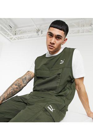 PUMA Avenir chest pocket sleeveless top in khaki exclusive to ASOS-Green