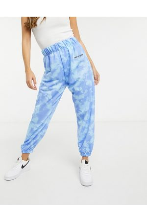 New Girl Order High waisted tracksuit joggers in blue tie dye