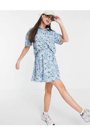 Heartbreak Wrap tie waist mini skirt co-ord in blue/white floral