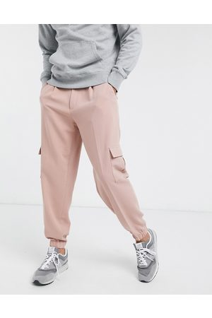 ASOS Oversized tapered smart jogger pants in pink with cargo pocket