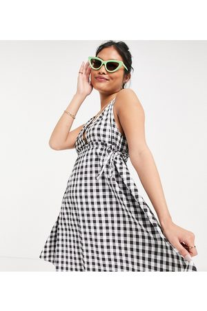 ASOS ASOS DESIGN Petite cotton poplin plunge mini sundress with ruched waist in mono gingham-Multi