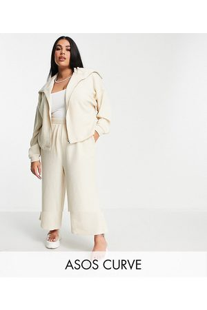 ASOS ASOS DESIGN Curve tracksuit zip through hoodie / culotte pants in fluffy texture in beige-White