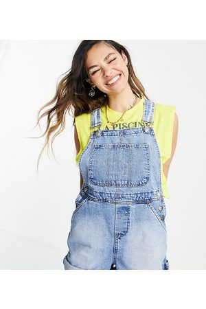 Reclaimed Vintage Inspired short overall in mid blue wash