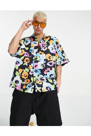 ASOS Boxy oversized revere shirt with all-over bright floral-Black