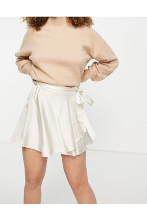 Bershka Satin mini wrap skirt in ecru-White