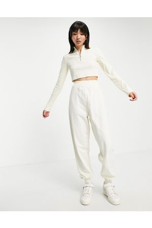 ASOS Tracksuit with rib funnel neck jacket and trackies in biscuit-Neutral