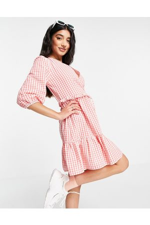 New Look Wrap tie tiered mini dress in pink gingham