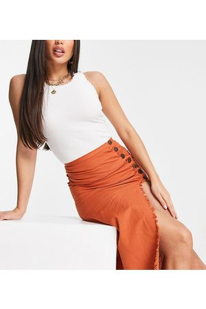 ASOS ASOS DESIGN Tall midi skirt with raw edge and button detail in rust-Orange