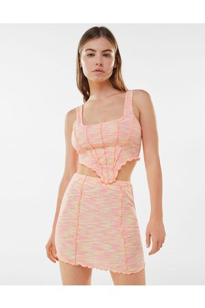 Bershka Space dye exposed seam mini skirt co-ord in pink