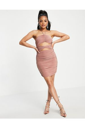 Club L Ruched cut out halterneck mini dress in pink