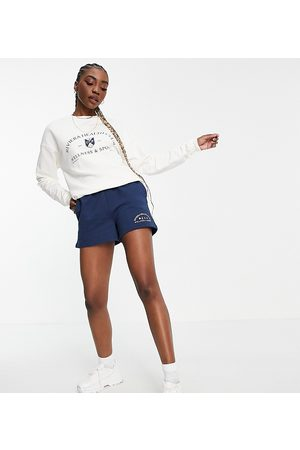 ASOS Hoodies - ASOS DESIGN Tall tracksuit sweatshirt / roll waist trackie short with riviera graphic in navy/cream-Multi