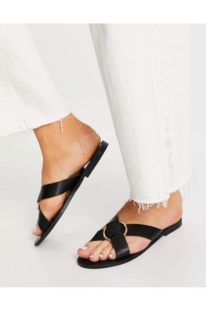 Glamorous Cross strap flat sandals with gold ring in black