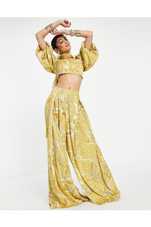 ASOS Pleat front wide-legged palazzo pants in yellow leaf print-Pink