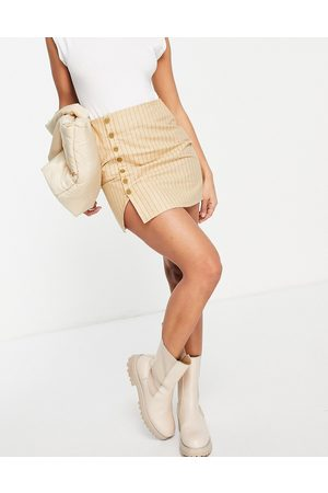 Motel Mini a-line skirt in stripe with button detail-Neutral
