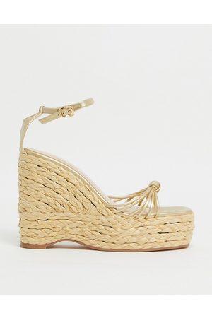 SIMMI Shoes Simmi London Nadir skinny strap espadrille wedge sandals in gold