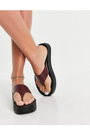 ASOS Fuelled chunky leather flipflops in burgundy-Red