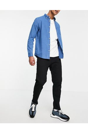 River Island Tapered - Tapered jeans in black