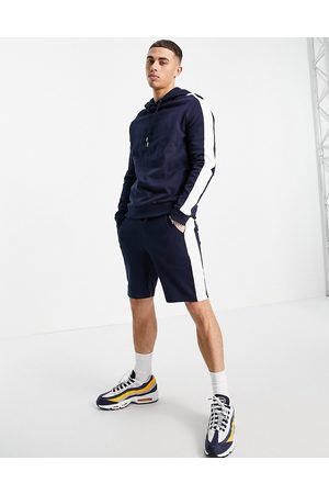 ASOS DESIGN Organic tracksuit with hoodie and shorts with side stripe in navy