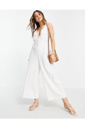 ASOS DESIGN Button-front lace trim swing jumpsuit in white