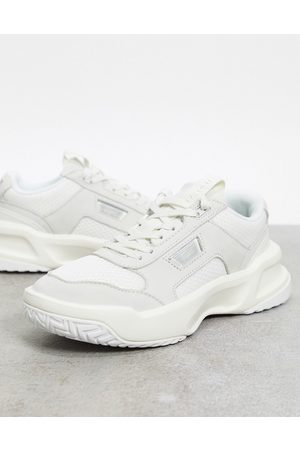 Lacoste Sneakers - Ace Lift chunky overlay sneakers in off white mix
