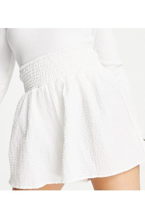 ASOS Petite ASOS DESIGN Petite short with shirred waist in puffed texture in white