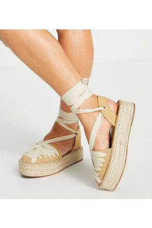 ASOS Wide Fit Junior flatform esadrilles with ankle tie in tan/cream-Brown
