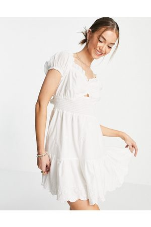 River Island Women Beach Dresses - Broderie puff sleeve shirred mini beach dress in cream-White