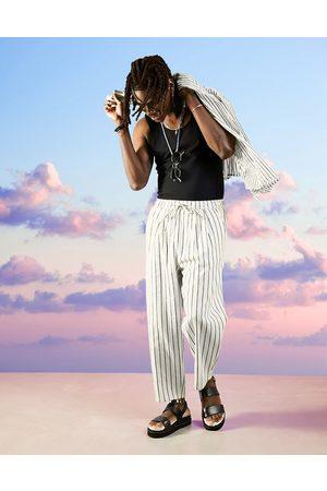 ASOS Wide-legged pants with pleats in linen stripe-Neutral