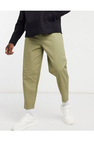 ASOS Oversized tapered fit chinos in light khaki-Green