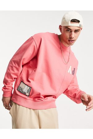 ASOS Outfit Sets - Co-ord oversized sweatshirt with cut- and-sew panelling and logo woven patches in pink