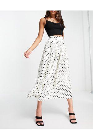 Little Mistress Women Printed Skirts - Pleated midi skirt with ruffle details in cream polka dot-Multi