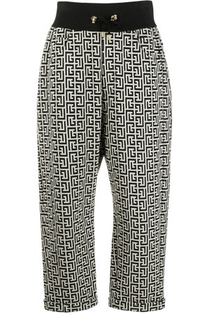 Balmain Motif-print high-waisted trousers