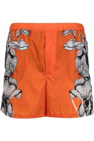 VALENTINO Men Board Shorts - Dark Blooming print swim shorts