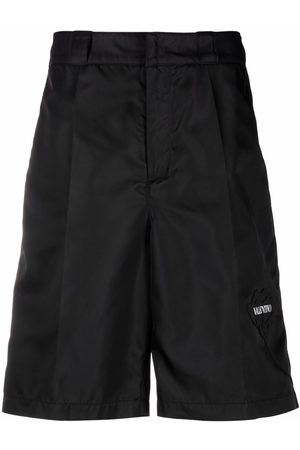 VALENTINO Logo-print knee-length shorts