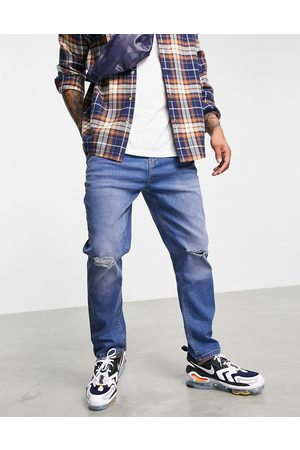 Le Breve Carrot fit ripped jeans in mid blue