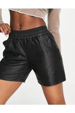 Muubaa Julia gathered waist leather shorts in black