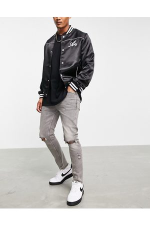 ASOS Skinny jeans with rips and raw hem in washed grey