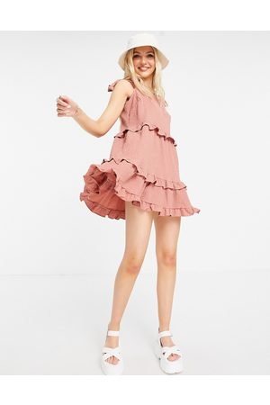ASOS Textured ruffle swing mini sundress with tie straps in pink
