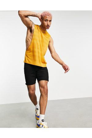 ASOS Relaxed tank with dropped armhole in mustard rib-Yellow