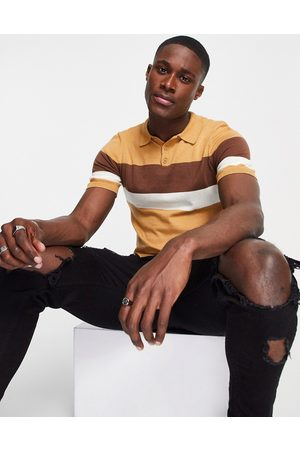 ASOS Knitted muscle fit polo with chest stripes in tan-Brown