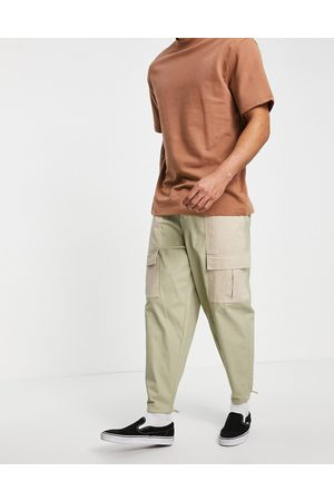ASOS Formal Pants - Oversized tapered pants with contrast laid on panels-Neutral
