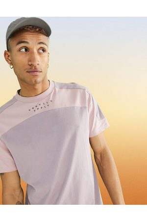 ASOS ASOS Unrvlld Spply standard t-shirt with cut & sew and logo print in purple-Pink