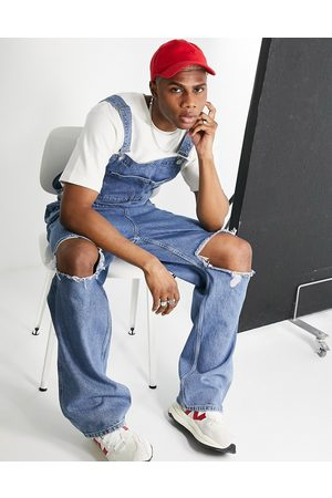 ASOS Baggy denim overalls in mid wash with knee rips-Blue